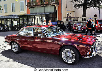 old luxury car with wire wheels