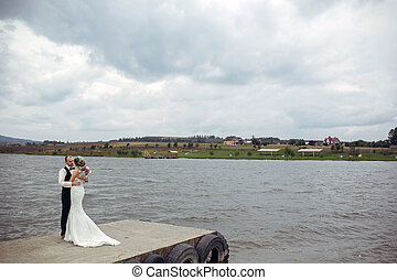 couple on pier - couple spending time at the lake on the...