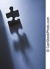 Jigsaw Piece with Dramatic Light - Backlit jigsaw piece...