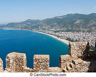 Castle of Alanya built on rocks and beach of Cleopatra,...