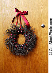 wooden door with a Christmas wreath