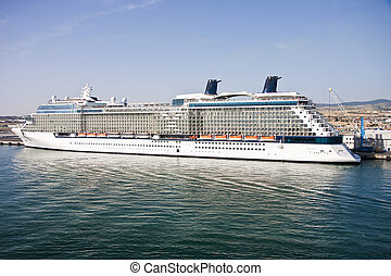 Cruise Ship at Italian Port - A luxury cruise ship anchored...