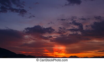 view of fantastic strange motion of red blue clouds at...