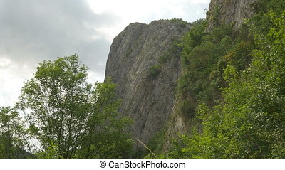 Steep Cliffs Wall - View of a high steep mountain slope with...