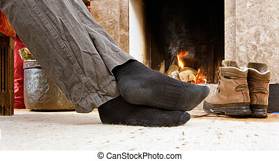 Feet by the fire - The feet of a hiker warming up by the...