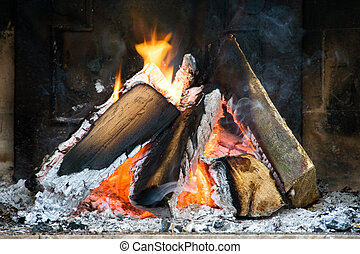Fireplace - Several logs burning in a small fireplace...