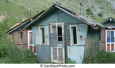 Dilapidated Houses - Pan shot to a group of abandoned and...