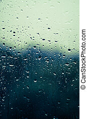 waterdrops - window glass covered by waterdrops