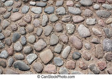 Cobblestone road - The road which has been laid out by...