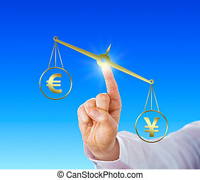 Yen Sign Outweighing The Euro On A Golden Scale