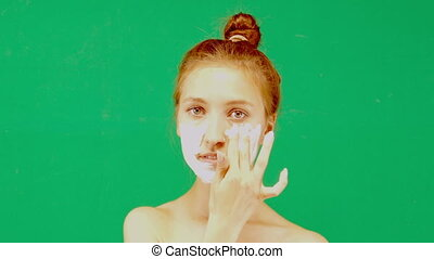 beauty women getting facial mask hromakey on a green...