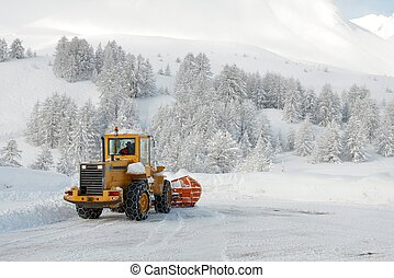 Snow - Big machine cleaning the snow from the road