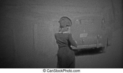 CHICAGO - 1942: Walking to the car - Unique vintage 8mm film...