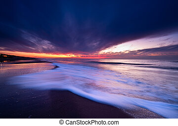 Sunset on the beach in the Netherlands - wild sunset at the...