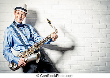 jazz man - Young expressive musician playing the saxophone....