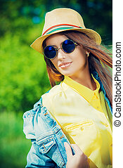windy day - Beautiful smiling girl wearing casual summer...