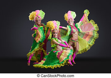 Sexy dancers posing in colorful carnival costumes