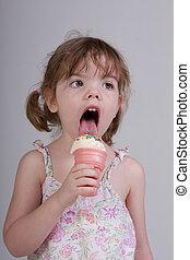 Little Girl Eating Ice Cream - Young girl eating ice cream...