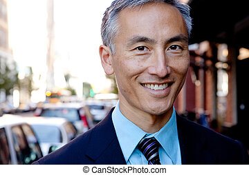 Middle Aged Businessman Standing Outside