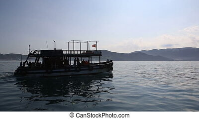 view of boat with divers drifting to islands against rope-way