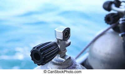 assistant binds with rope oxigen cylinder for diving to boat...