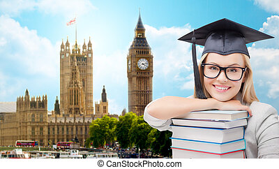 student in trencher cap with books over london - education,...