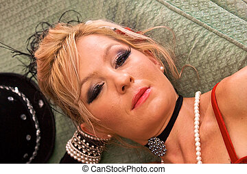 portrait of a strumpet - Portrait of beautiful blonde laying...