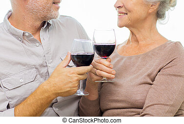 close up of happy senior couple with red wine - family,...