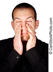 Sinus Pressure - A man with sinus pressure in front of a...