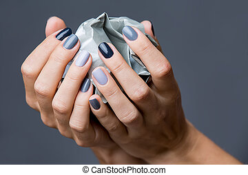 Stylish manicure in shades of gray female elegant handles...