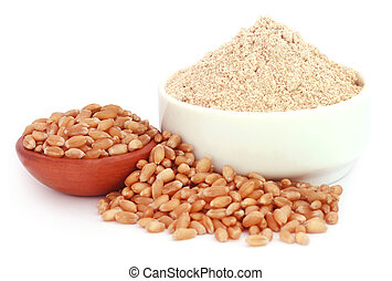 Wheat and reddish flour over white background