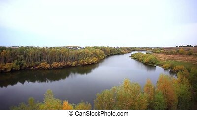 view from the cliff on Autumn forest and river in the fall...