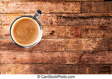 Coffee on old wood wall background.