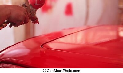 Painter paint the red car in garage