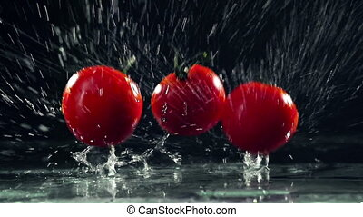 Tomato Splash - Dynamic shot of three tomatoes falling on...