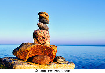 Parity - Balancing of stones each other on the seashore