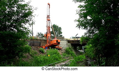 pile poppethead on railroad and bridge - pile rig repair...