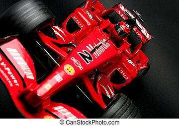 curve - closeup image of front part of formula one toy