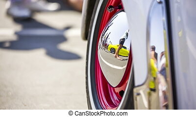Reflection In the Hubcap Of Old Car Wheel Disk
