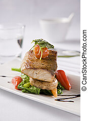 Grilled Fish served with salad peppers and tomato