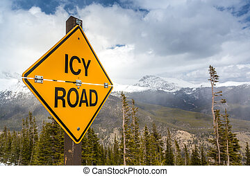 Icy Road Sign in Rocky Mountains National Park, Colorado,...
