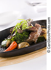 Honey and Pepper Sizzling Beef and vegetables - Prime ribeye...