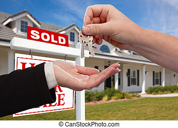 Handing Over the House Keys in Front of Sold New Home...