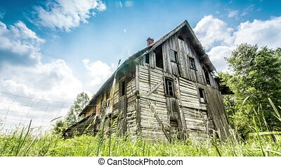 Spooky house on a green meadow. - Spooky house on a very...