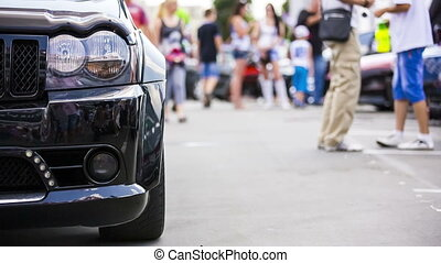 People Walking At Car Exhibition