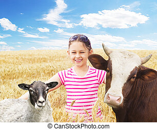 child and a cow and a sheep