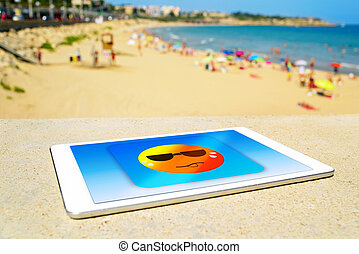 icon of a sun sweating in a tablet computer at the beach - a...
