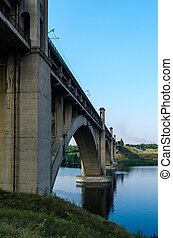 road and rail split-level bridge over the river on a...