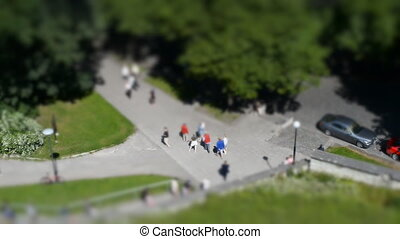 Tourists in the city. Tilt-shift.
