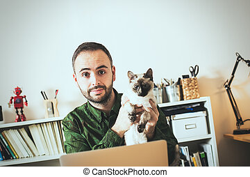 Hipster businessman working with his pet in a modern office.